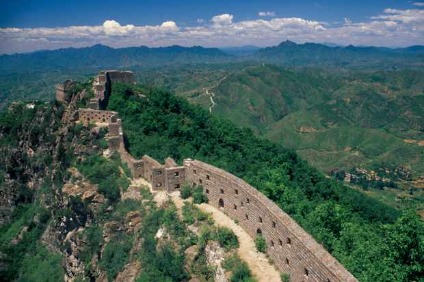 A thin section of the Great Wall of China near Beijing disappearing into the distant hills. (Photo by Eye Ubiquitous/UIG via Getty Images)