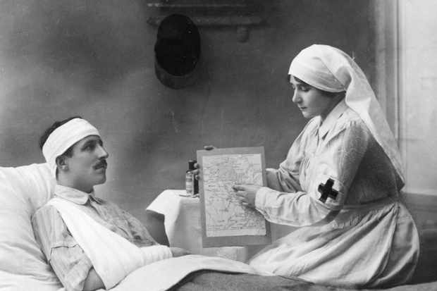 A nurse on the French Eastern border treats a wounded soldier during the First World War. (Photo by Roger Viollet/Getty Images)