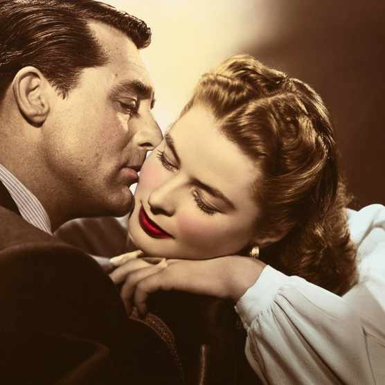 While young ladies may have been daydreaming of handsome film stars such as Cary Grant, pictured here kissing the cheek of Ingrid Bergman in a publicity still for the 1946 film 'Notorious', agony aunts were keen to bring them back down to earth. (Photo by John Springer Collection/CORBIS/Corbis via Getty Images)
