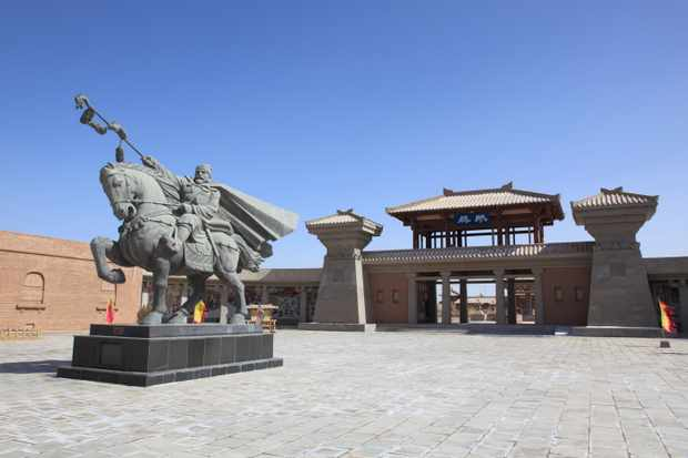 Yangguan Museum and a statue of Zhang Qian. (Getty Images)