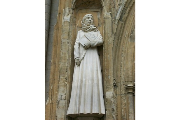 Julian of Norwich holds her famous book in a sculpture at the doors of Norwich Cathedral. (Photo by Creative Commons Wiki)