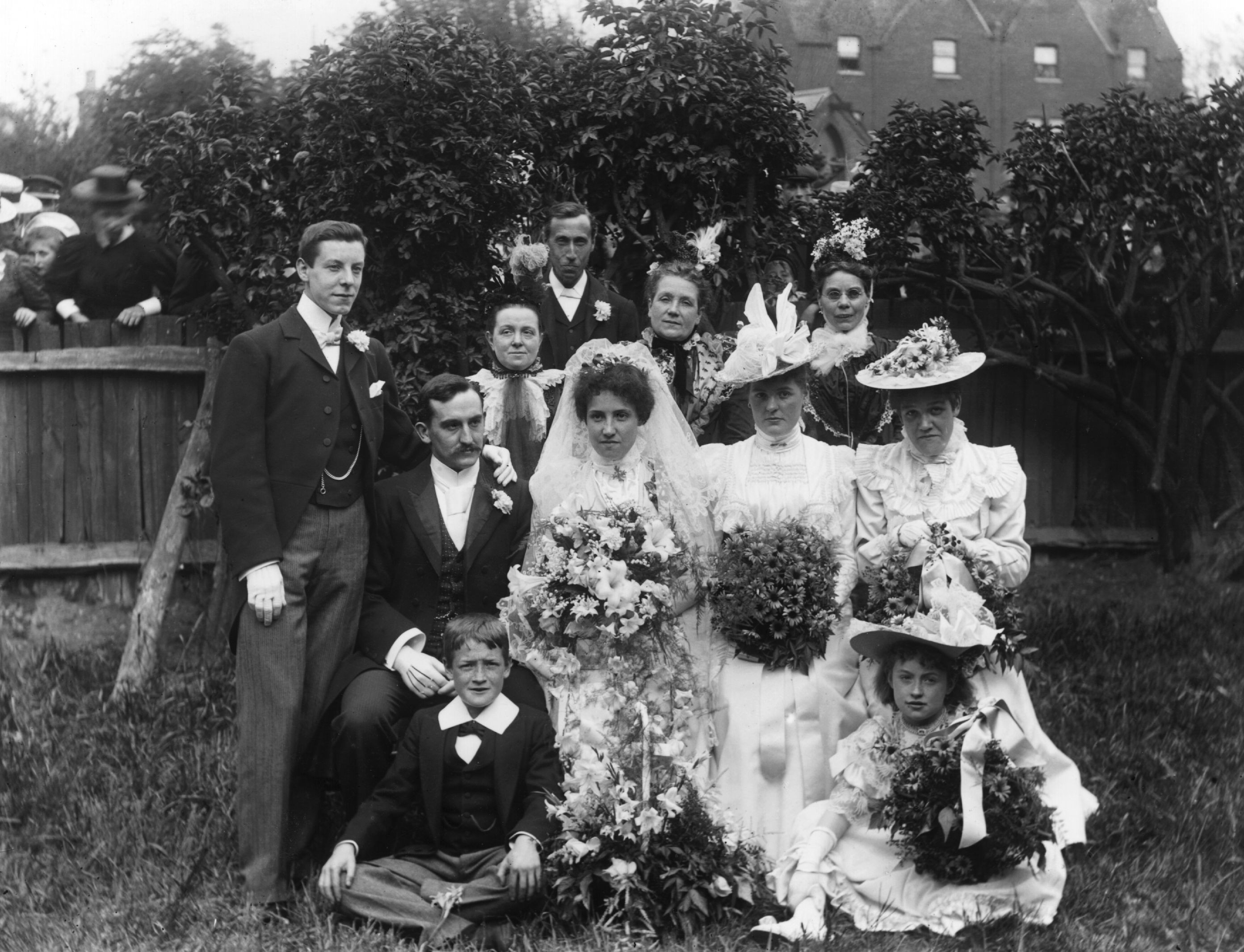 Victorian wedding, circa 1900: A wedding group poses in the garden, 1900. (Photo by F J Mortimer/Getty Images)