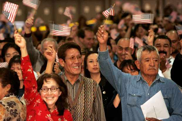 New US citizens celebrate after taking the oath at a US District Court for the Central District of California naturalisation ceremony, 2007. (Photo by Anne Cusack/Los Angeles Times via Getty Images)