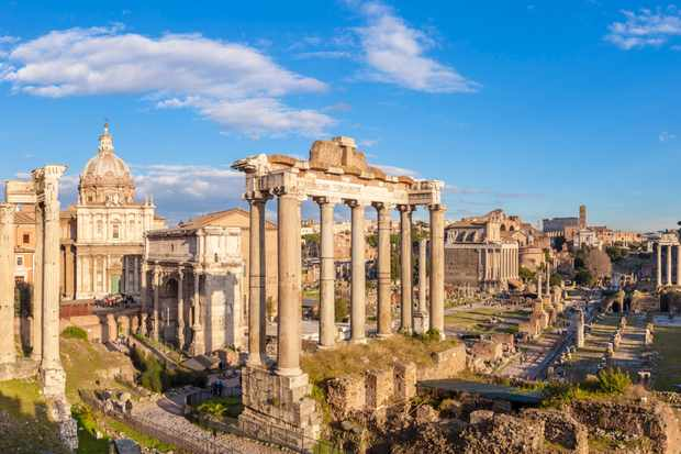 The columns of the Temple of Saturn and overview of the ruined Roman Forum, UNESCO World Heritage Site, Rome. (Getty Images)