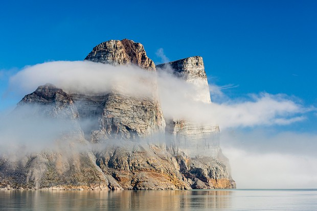 Rocky cliffs loom above the fjords of Baffin Island in the Canadian Arctic. Sir John Franklin's expedition faced harsh conditions in summer - and life-threatening cold and hunger in winter (Michael Nolan/robertharding Getty Images)