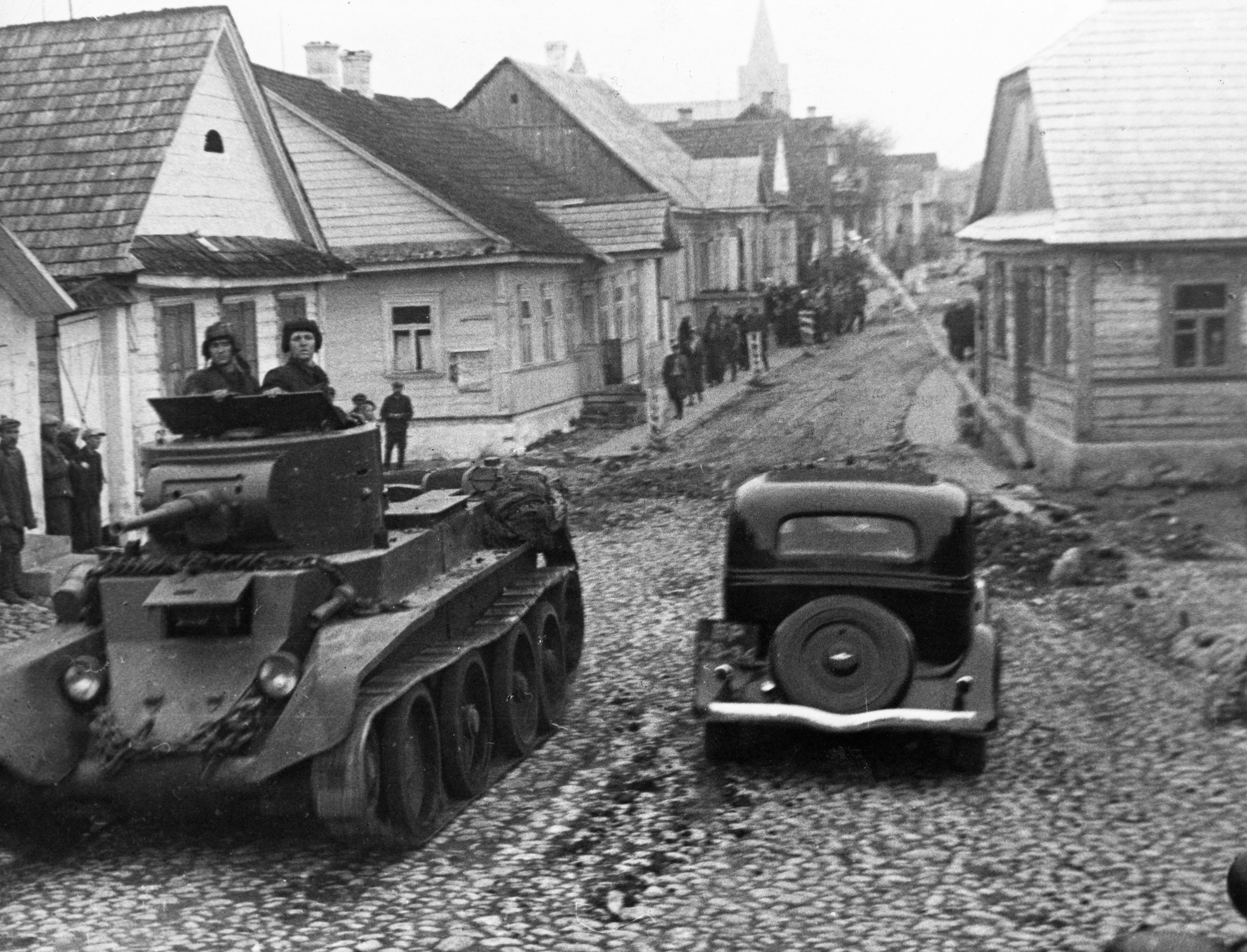 Red Army tank drivers on a street in the city of Rakov, Poland