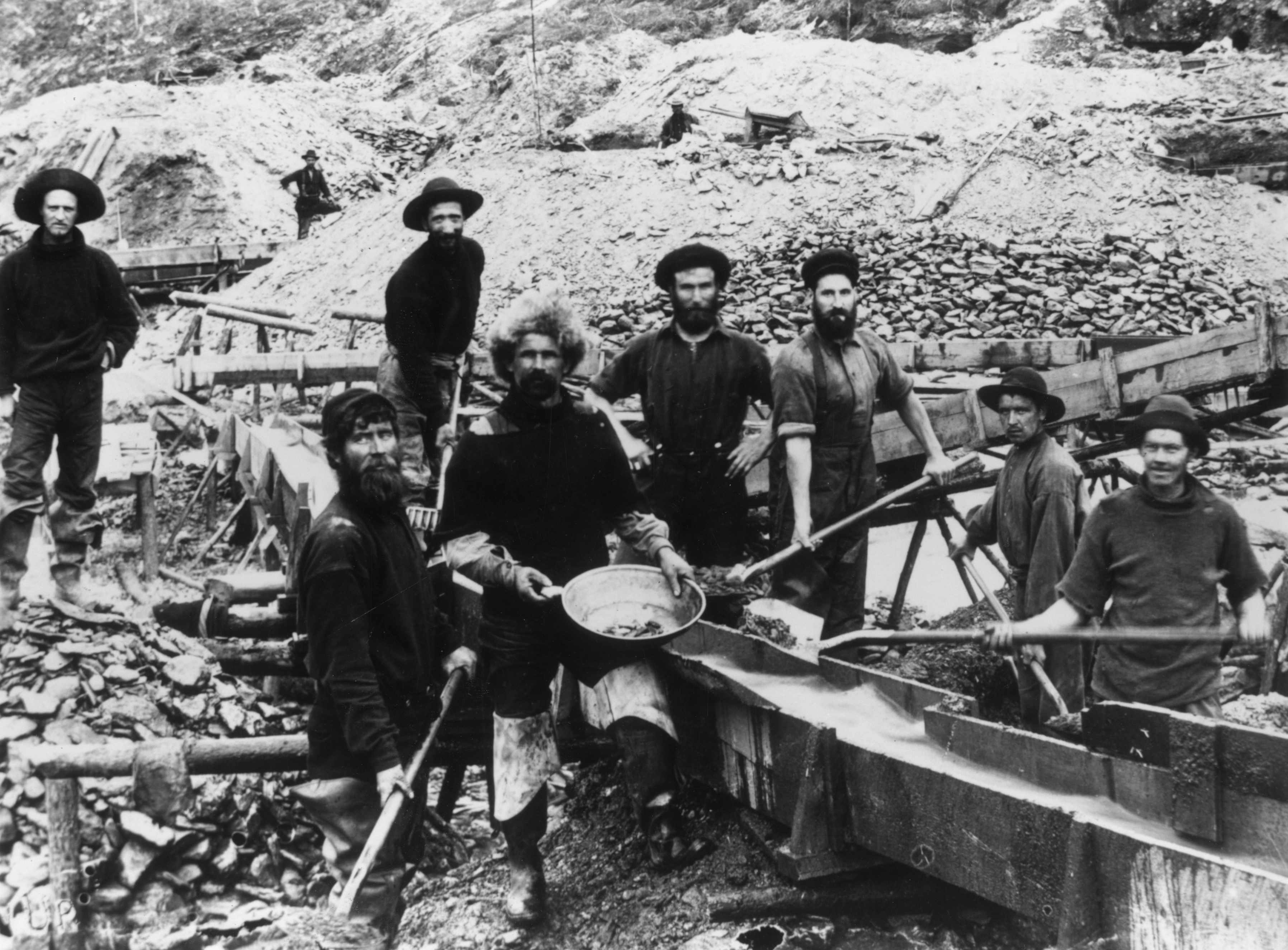 Jubilant miners display a large gold nugget during the Klondike Gold Rush, c1897. (Photo by Hulton Archive/Getty Images)