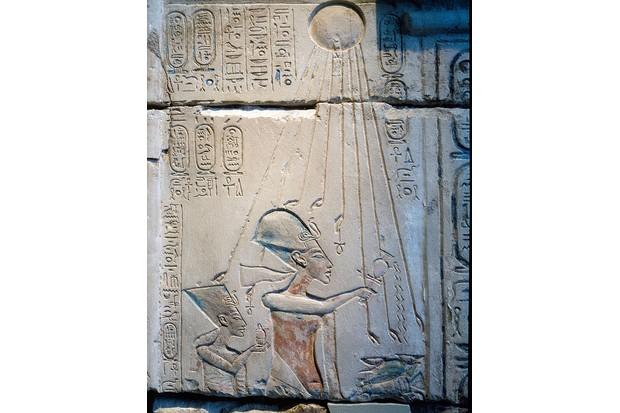 Akhenaten and Nefertiti offering libations to Aten, the sun god