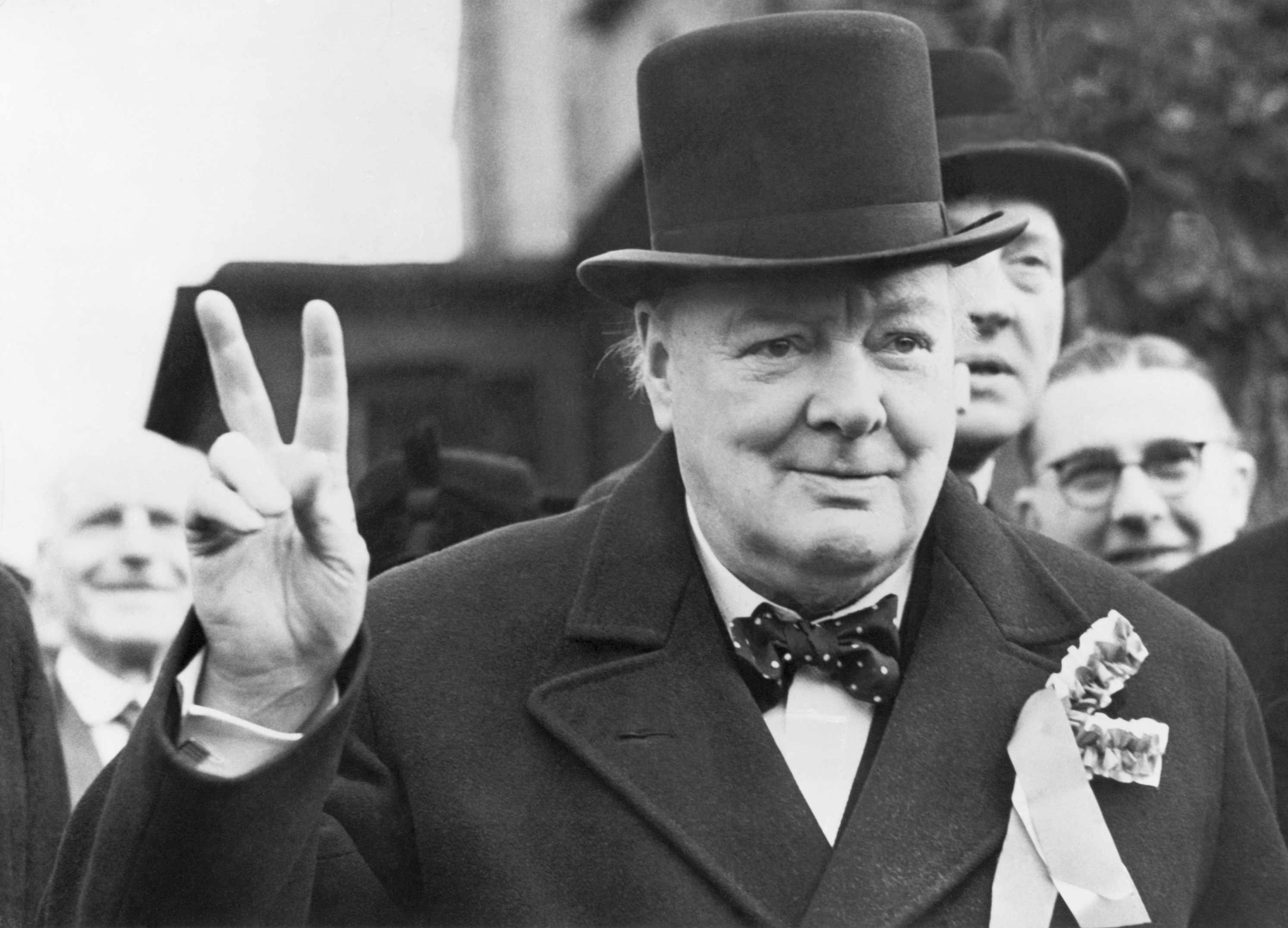 Winston Churchill, former prime minister of the United Kingdom, gives his 'victory' sign while making a polling day tour of his constituency during an election. (Getty Images)