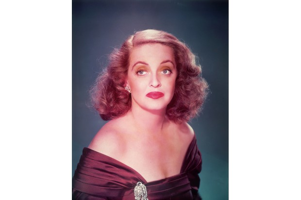 Stars such as Bette Davis, pictured above in a promotional portrait for the film 'All About Eve', were referenced by gay men and women in the 1930s to drop hints about sexuality. (Photo by Hulton Archive/Getty Images)