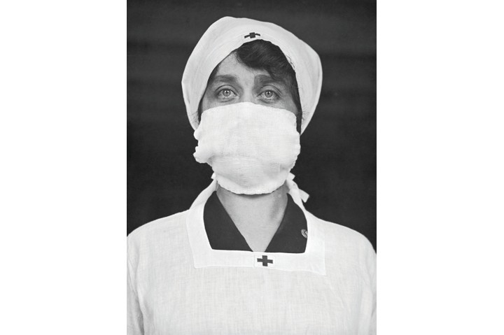 A Red Cross worker in the United States wears a mask to stop the spread of Spanish Flu
