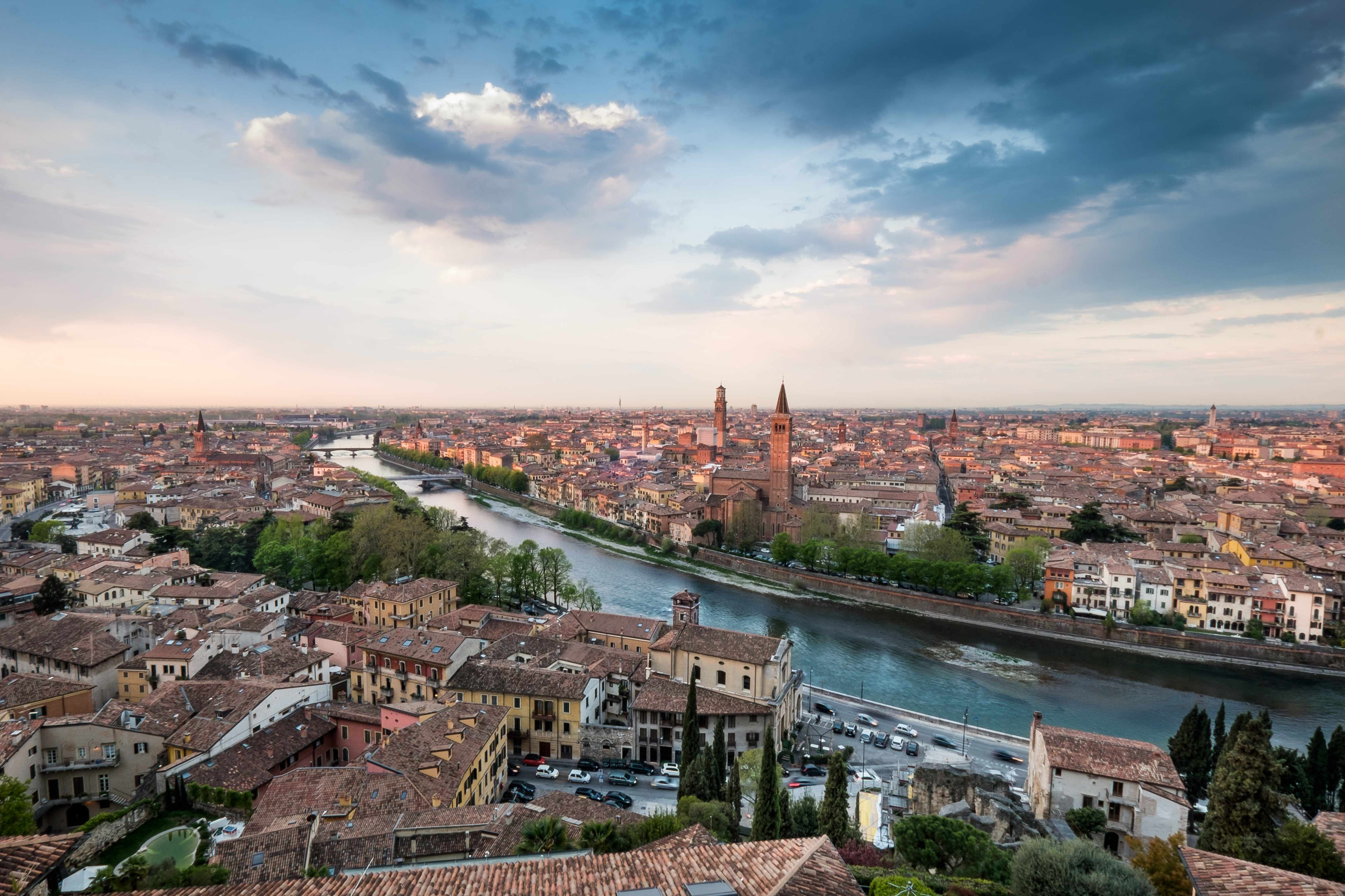 Verona skyline with river Adige, bridges, Santa Anastasia Church and Torre dei Lamberti or Lamberti Tower at dawn view from Castel San Pietro, Italy. (Getty Images)