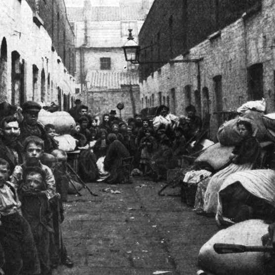 A London slum family stood in a street with all their possessions following eviction, c1901. (Photo by Hulton Archive/Getty Images)