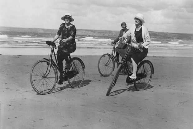 A group of women cycling along the beach at Newquay, c1923. (Photo by Topical Press Agency/Getty Images)