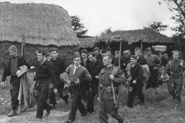 Italian prisoners of war being escorted under armed guard to work on a farm, 13 September 1941. (Photo by Keystone/Getty Images)