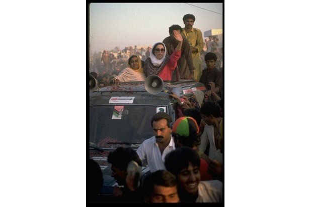 Pakistani leader Benazir Bhutto, a PPP candidate (Pakistan People's Party), campaigning from the sun roof of a car. (Photo by Robert Nickelsberg/The LIFE Images Collection/Getty Images)