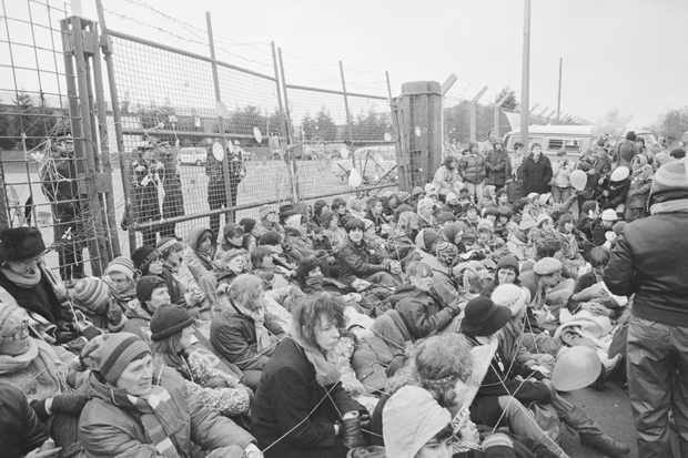 Demonstrators block the gates of the Greenham Common Airbase, tied together with string. The demonstrators were members of the Campaign for Nuclear Disarmament (CND) group. (Getty Images)