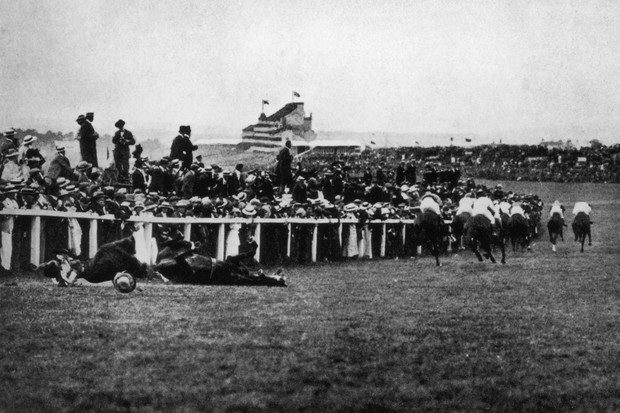 Emily Davison is felled by King Edward VII's horse, Anmer, moments after trying to grab his reins during the running of the Derby, 4 June 1913. The suffragette suffered a fractured skull and internal injuries. She died four days later. (Getty)