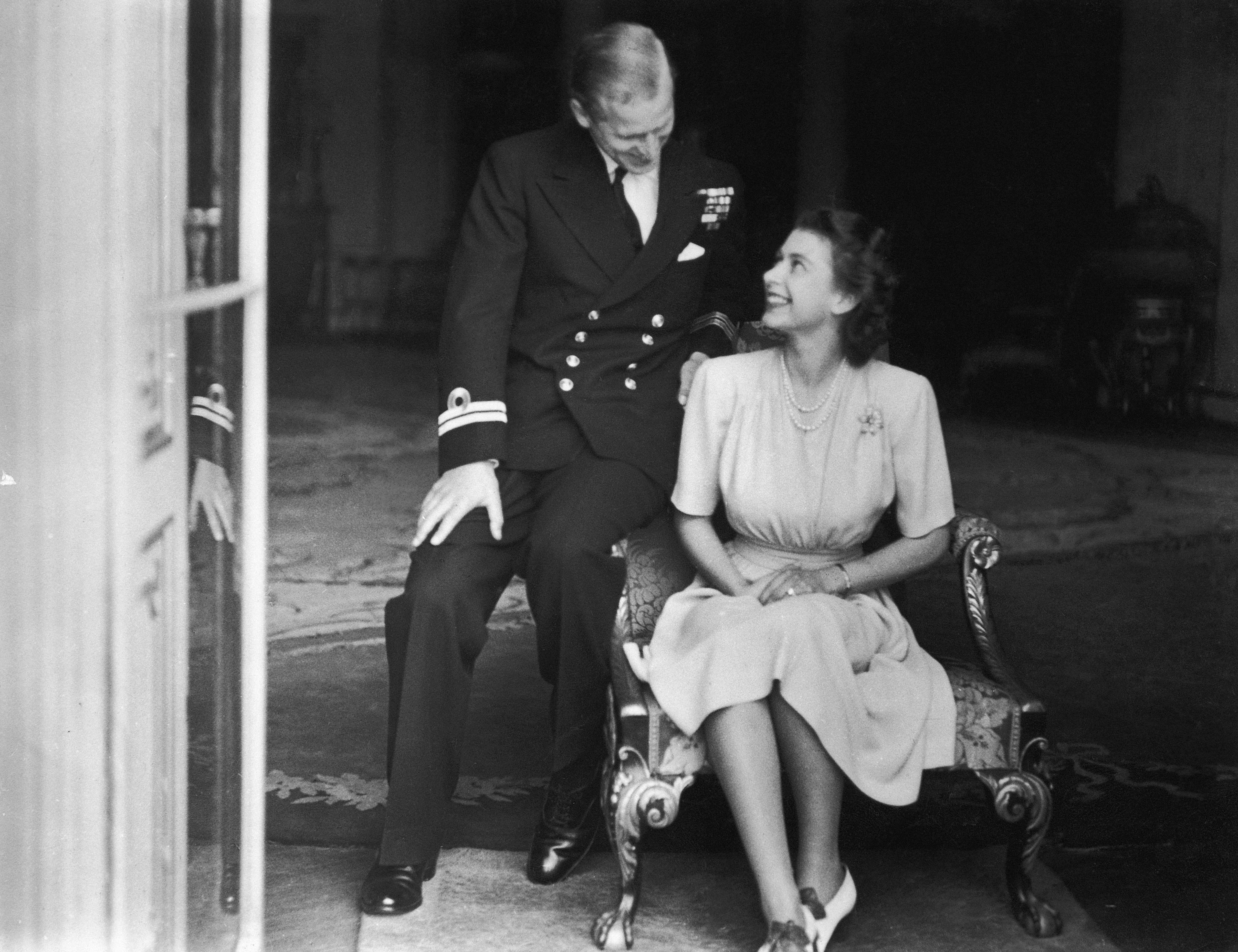 Princess Elizabeth (later Queen Elizabeth II) and her fiance, Philip Mountbatten at Buckingham Palace, after their engagement was announced, 10th July 1947. (Photo by Topical Press Agency/Hulton Archive/Getty Images)