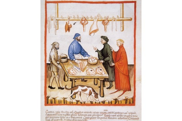 Butchery depicted in a 14th-century handbook of health. (Getty Images)