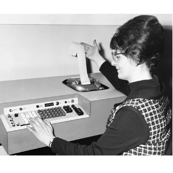 A female computer programmer demonstrates a new computer in the 1960s. (Photo by © Hulton-Deutsch Collection/CORBIS/Corbis via Getty Images)