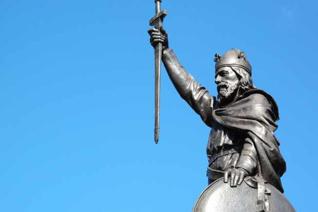 King Alfred The Great's statue designed by Hamo Thornycroft and erected in 1899 stands at the eastern end of the Broadway in Winchester, Hampshire, England. (Photo by Tony Baggett/iStock/Getty Images Plus)