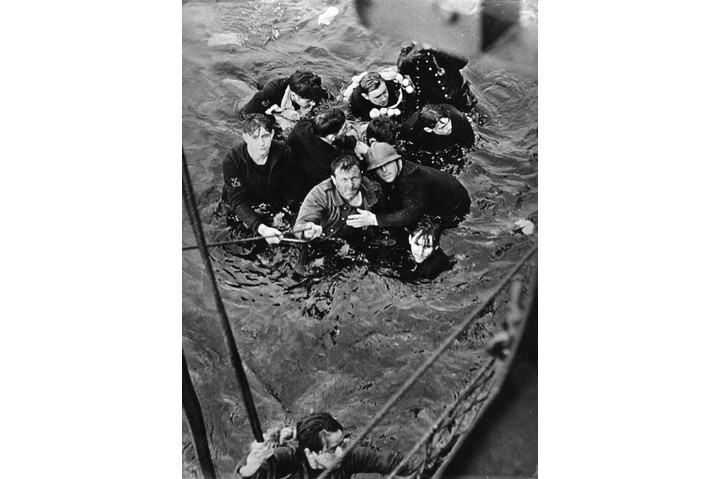 Crew members of the French destroyer Bourrasque, sunk by mine at Dunkirk, are hauled aboard a British vessel from their sinking life-raft. (Photo by Hulton Archive/Getty Images)