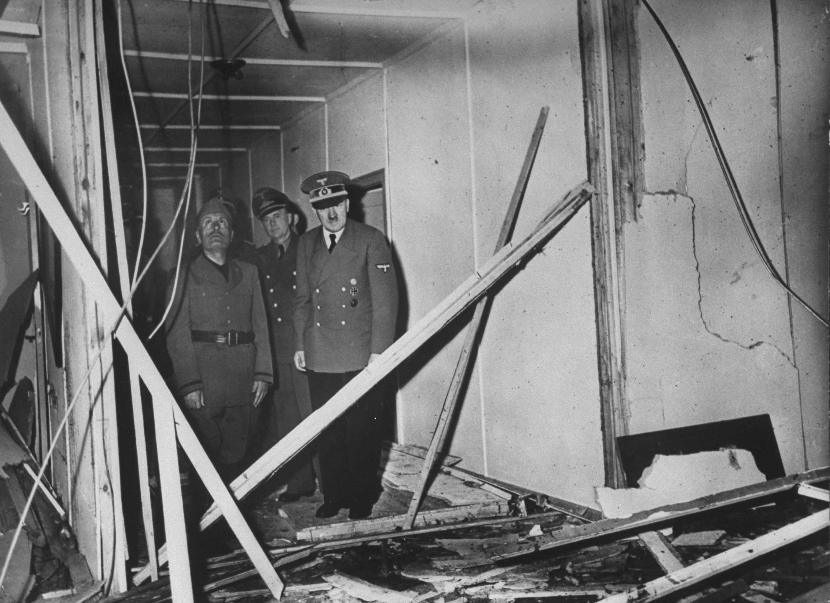 Deposed Italian dictator Benito Mussolini, German officer Paul Schmidt and Adolf Hitler survey damage at Hitler's eastern front military headquarters, 'the Wolf's Lair', hours after a failed bombing attempt by Lieutenant Colonel Claus von Stauffenberg. (Photo by Heinrich Hoffmann/The LIFE Picture Collection/Getty Images)