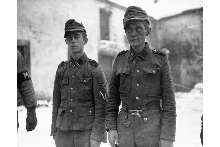 Two Hitler Youth who have surrendered to Allied Forces, Germany, 1945. (Photo by © CORBIS/Corbis via Getty Images)