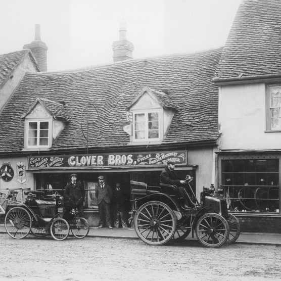 Veteran cars – a 1898 Benz and an early Panhard – outside Glover Brothers Cycle Makers, c1900. (Photo by National Motor Museum/Heritage Images/Getty Images)