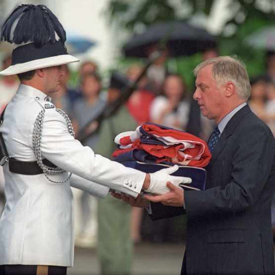 Chris Patten, the last governor of colonial Hong Kong, is pictured here receiving the Union Jack flag shortly beforeHong Kong was returned to China, ending over a century of British rule. (Emmanuel Dunand/AFP/Getty Images)