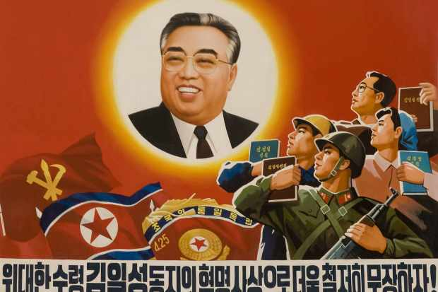A soldier and workers are depicted gazing in admiration at North Korea's first premier, Kim Il-sung, in a propaganda poster. The Kims' dynastic personality cult shows no signs of diminishing. (Photo by Eric Lafforgue/Gamma-Rapho via Getty Images)