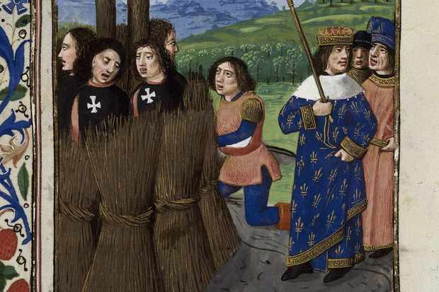 The burning of Templars, from 'De casibus virorum illustrium' by Giovanni Boccaccio. Found in the collection of the British Library. (Photo by Fine Art Images/Heritage Images/Getty Images)