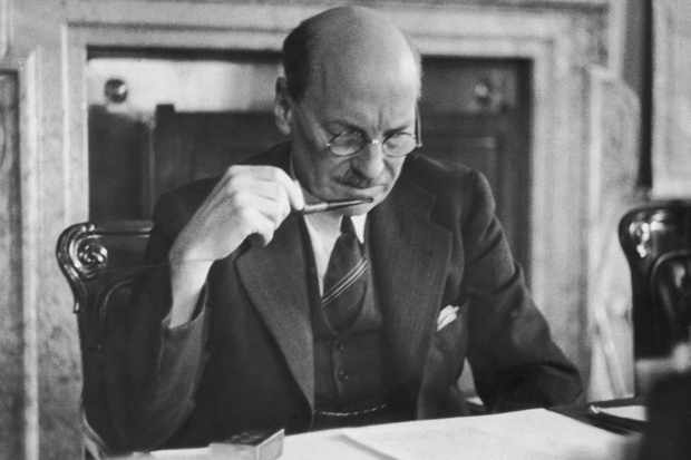 British prime minister Clement Attlee reading a document in his office, 27 July 1946. (Photo by Haywood Magee/Picture Post/Hulton Archive/Getty Images)
