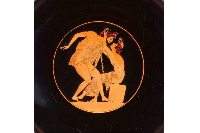 An Athenian red-figure kylix (cup) dating from around 510–500 BC depicts a young pentathlete pulling his older lover towards him for a kiss. In many of the city-states of ancient Greece, sex between a man and a youth was an accepted – even idealised – form of love, its virtues extolled in works by writers including Plato. (Photo by Fine Art Images/Heritage Images/Getty Images)