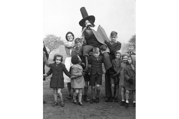 The staff and children of the Aldersbrook Children's Home, Wanstead, celebrating Guy Fawkes Day c1947. (Ron Burton/Keystone/Getty Images)