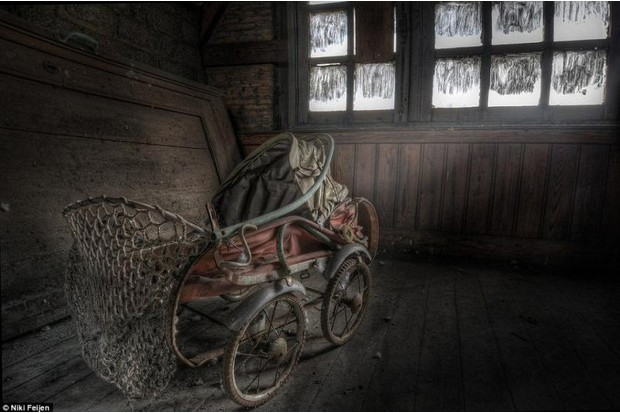 Photo of a baby buggy left in a derelict house