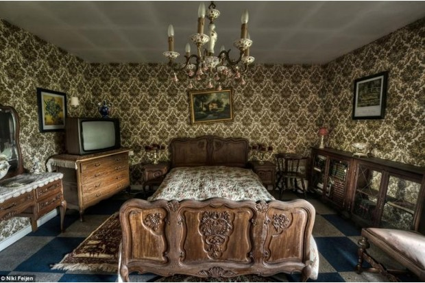 Photo of a deserted house bedroom with large bed