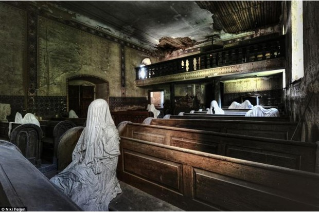 Photo of a deserted church interior with spooky shaped sheets