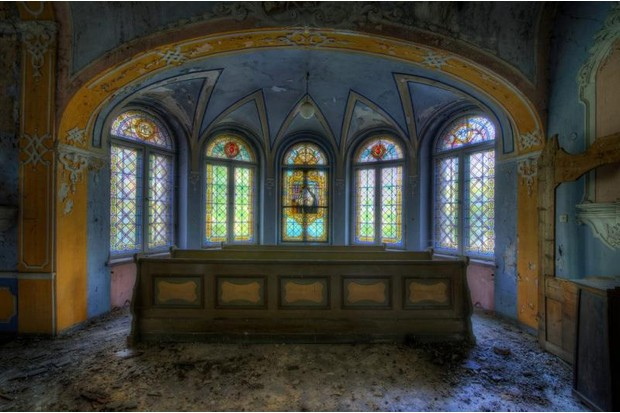 Photo of stained glass in a deserted church