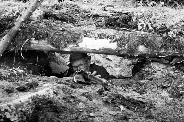 Häyhä shows his method of shooting from a covered foxhole. Note the way he has placed his gloves; they are used to reduce the jolt of the weapon. The supporting hand is behind the trigger guard to give the best possible position. (© Tapio Saarelainen)