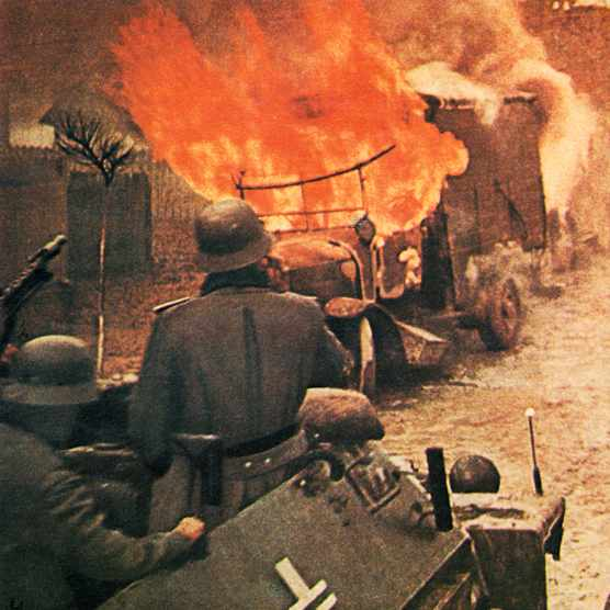 Operation Barbarossa, German soldiers in  armoured vehicle of the Wehrmacht are approaching a burning Russian truck. 1943 They are part of over 4.5 million troops of the Axis powers during the invasion of the USSR. Soviet Union. (Photo by Galerie Bilderwelt/Getty Images)