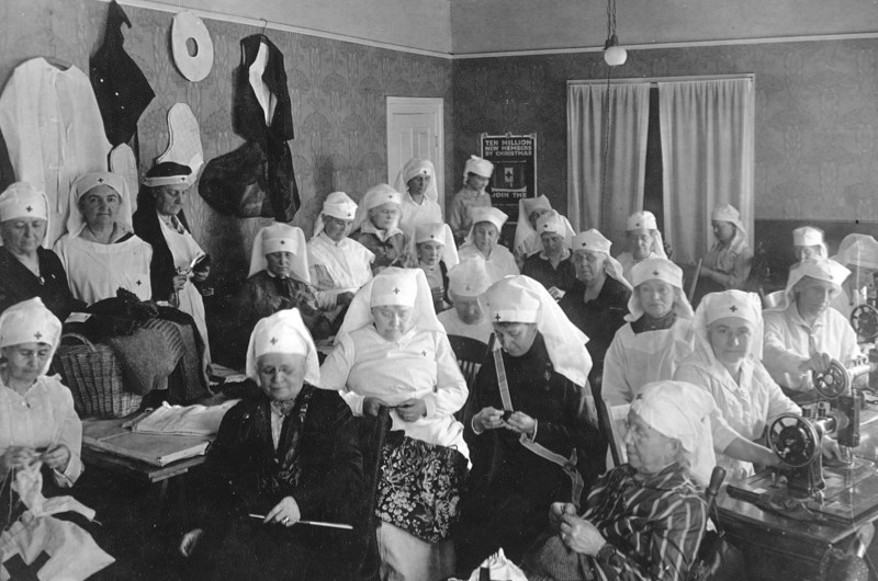 Women of the Sarah Caswell Angell chapter of the Daughters of the American Revolution, from Ann Arbor, Michigan, engaging in war work activities to assist the Allied cause during the First World War, 1918. During their sessions they knitted, made hospital garments, sewed for French children, and made aviators' vests. (Photo by PhotoQuest/Getty Images)