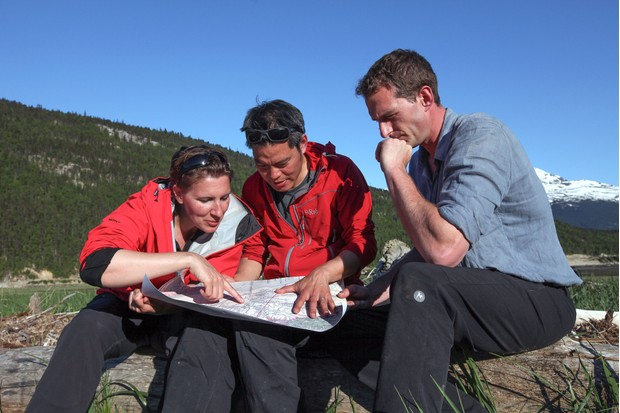 Programme Name: Operation Gold Rush with Dan Snow - TX: n/a - Episode: Operation Goldrush with Dan Snow - ep 1 - Mountain Passes (No. 1) - Picture Shows: studying a historic map at Dyea, Alaska; the start pointing for both the gold seekers of 1898 and where they too will start their 550 mile journey north following in their footsteps. Felicity Aston, Kevin Fong, Dan Snow - (C) BBC - Photographer: Stefania Buonajuti