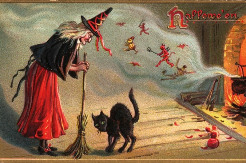 This Halloween postcard, which features a witch, a black cat, and lots of little spirits, was printed mid-1900s in New York City. (Photo by Transcendental Graphics/Getty Images)
