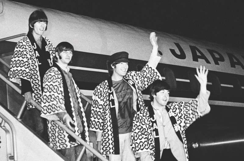 Happi arrival in Japan: The Beatles leave the plane wearing traditional happi coats given to them by the airline. Unfortunately their visit fell foul of cultural sensitivities, and political interests almost prevented their performances from going ahead. (Topfoto)