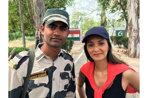 Programme Name: Dangerous Borders: A Journey across India & Pakistan - TX: n/a - Episode: n/a (No. 3) - Picture Shows: with Border control officer - India. Babita Sharma - (C) October Films - Photographer: Production