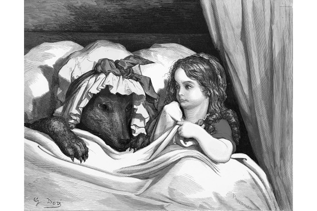 Illustration by Gustave Dore taken from Charles Perrault's 'Little Red Riding Hood'. Little Red Riding Hood sits in the bed next to the wolf, disguised in her grandmother's night-cap. Taken from Perrault's 'Les Contes de Perrault', c1860s. (Photo by Culture Club/Getty Images)