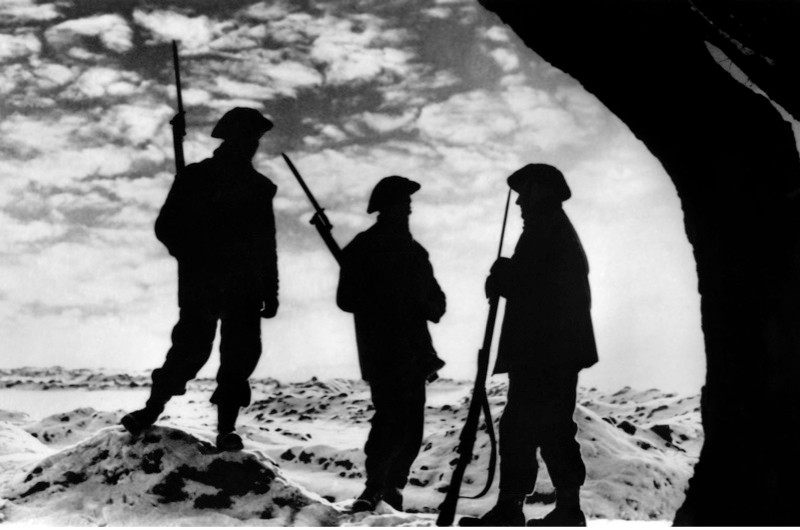 Sunset on the Western Front during the Second World War – watchmen at their posts. Official British postcard issued by the Ministry of Information. War Office Photograph B. 1370. (Photo by Culture Club/Getty Images)