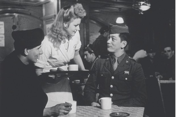 A British waitress serves American servicemen inside Rainbow Corner, Piccadilly, January 1945. (Getty Images)